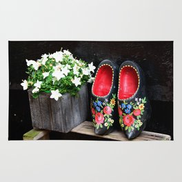 Clogs and te flowers Rug