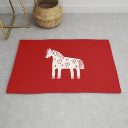 Dala horse on red Rug