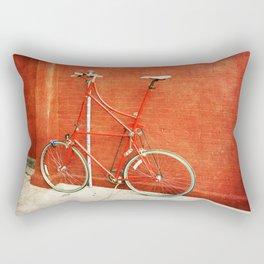 Red Tall Bike Against Brick Wall Rectangular Pillow