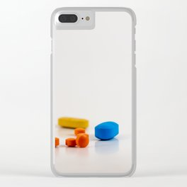 Colored medicines on a neutral background Clear iPhone Case