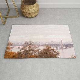 Dreamy Seoul city view with bridge across Han river Rug