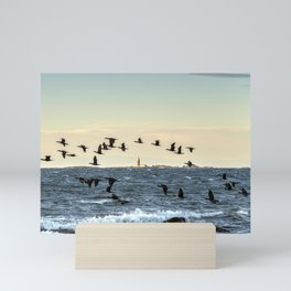 Flying flock of cormorants Mini Art Print