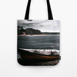Boat on frozen shore Tote Bag