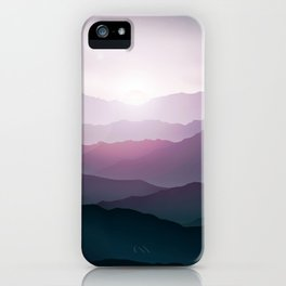 dark blue mountain landscape with fog and a sunrise and sunset iPhone Case