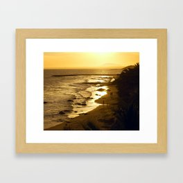Coconut palms and sand beach, people swimming on sunset. Framed Art Print