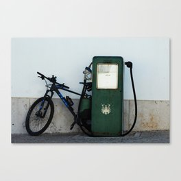 Vintage gas pump with attached bike Canvas Print