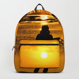 A Girl watching sunset..... Backpack