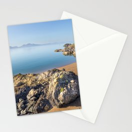 Volcanic rock and beach on Llanddwyn Island, Anglesey, Wales, Llyn peninsula in the background Stationery Cards