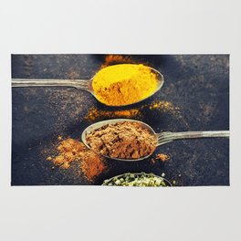 Colorful spices in metal spoons Rug