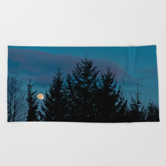 Full moon in the firs Beach Towel