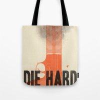 die hard Tote Bags featuring Die Hard by Wharton
