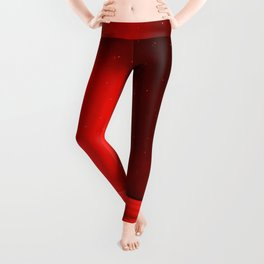 Red glowy and starry night with calm waves at the beach by the ocean Leggings