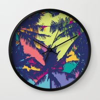 palm tree Wall Clocks featuring Palm tree by PINT GRAPHICS