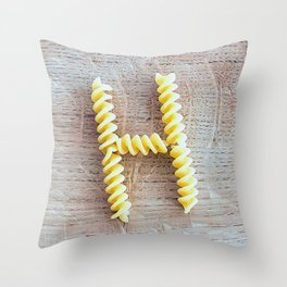 Letter H composed with pasta fusilli on a wooden chopping board Throw Pillow