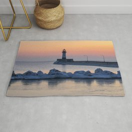 Sunrise at North Pier Lighthouse Rug