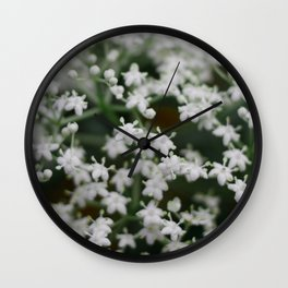 Small little white flowers Wall Clock