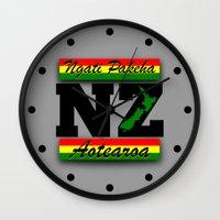 new zealand Wall Clocks featuring New Zealand  by mailboxdisco