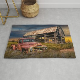 Red Pickup Truck with Weathered Barn in a Rural Landscape Rug