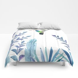 Hummingbird with tropical foliage Comforters