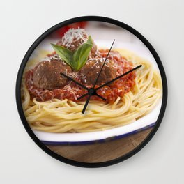 Spaghetti with meatballs and parmesan cheese on a rustic table Wall Clock
