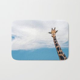 Giraffe neck and head against the clear blue sky Bath Mat