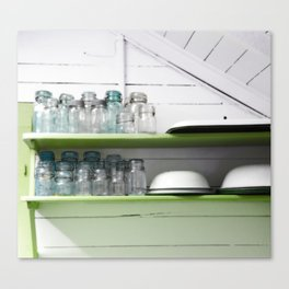 Rustic Kitchen with White Shiplap and Greenery Shelves with Vintage Blue Jars Canvas Print