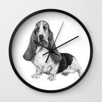 the hound Wall Clocks featuring Basset Hound by Danguole Serstinskaja
