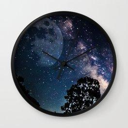 Starry skies and rising moon Wall Clock