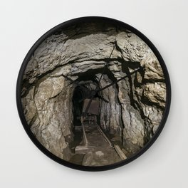 Mine cart in an old abandoned mine cave. Near Matlock, Derbyshire, UK. Wall Clock