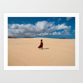 Young woman walking across sand dune in Canary Island  Art Print