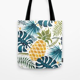 Golden pineapple on palm leaves foliage Tote Bag