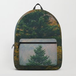 Foggy autumn forest layers disappearing in fog Backpack