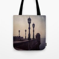 guardians Tote Bags featuring Guardians by Out of Line