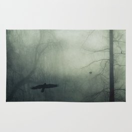 world wrapped in mist Rug