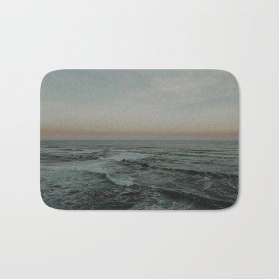 The calm ocean Bath Mat