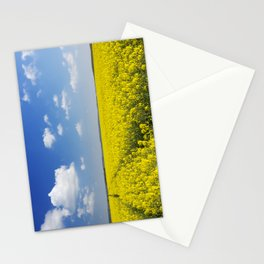 Path through blooming canola under a blue sky with clouds Stationery Cards