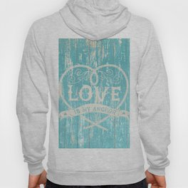 Maritime Design - Love is my anchor on teal grunge wood background Hoody