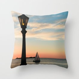 Colonia Vibes. Beautiful sunset scene with a boat in Colonia del Sacramento, Uruguay Throw Pillow