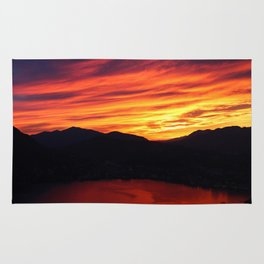 Sunset behind the mountains Rug