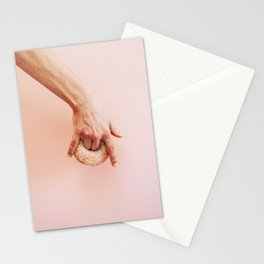 hand holds donut Stationery Cards