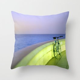 A bike ride at dusk in Nice Throw Pillow