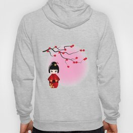 Japanese kokeshi doll at sakura blossoms Hoody