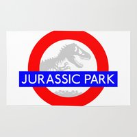 jurassic park Area & Throw Rugs featuring LONDON UNDERGROUND : JURASSIC PARK STATION by DrakenStuff+