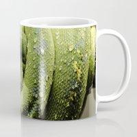 monty python Mugs featuring Python by Katherine Ridgley