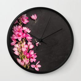 Fresh pink flowers on dark slate table Wall Clock