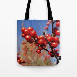 Winterberries glow against a blue autumn sky Tote Bag