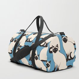 Siamese Cats crowd on blue Duffle Bag