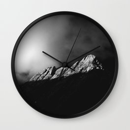 Last sun rays on the mountain in black and white Wall Clock