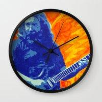 grateful dead Wall Clocks featuring Jerry Garcia - The Grateful Dead by Tipsy Monkey