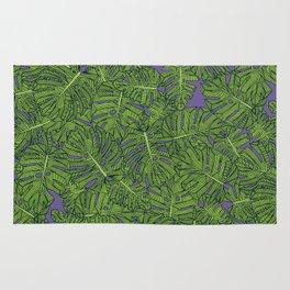 monstera leaves green purple Rug